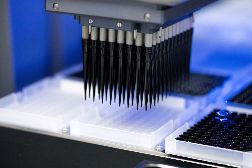 A battery of pipettes on a robot used for gene sequencing. (Helix via AP)