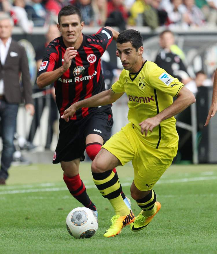 Frankfurt's Carlos Zambrano (left) chases down Dortmund's Henrikh Mkhitaryan during Bundesliga action in Frankfurt, Germany, Sunday.  Dortmund won the game 2-1. (Micheal Probst / The Associated Press)