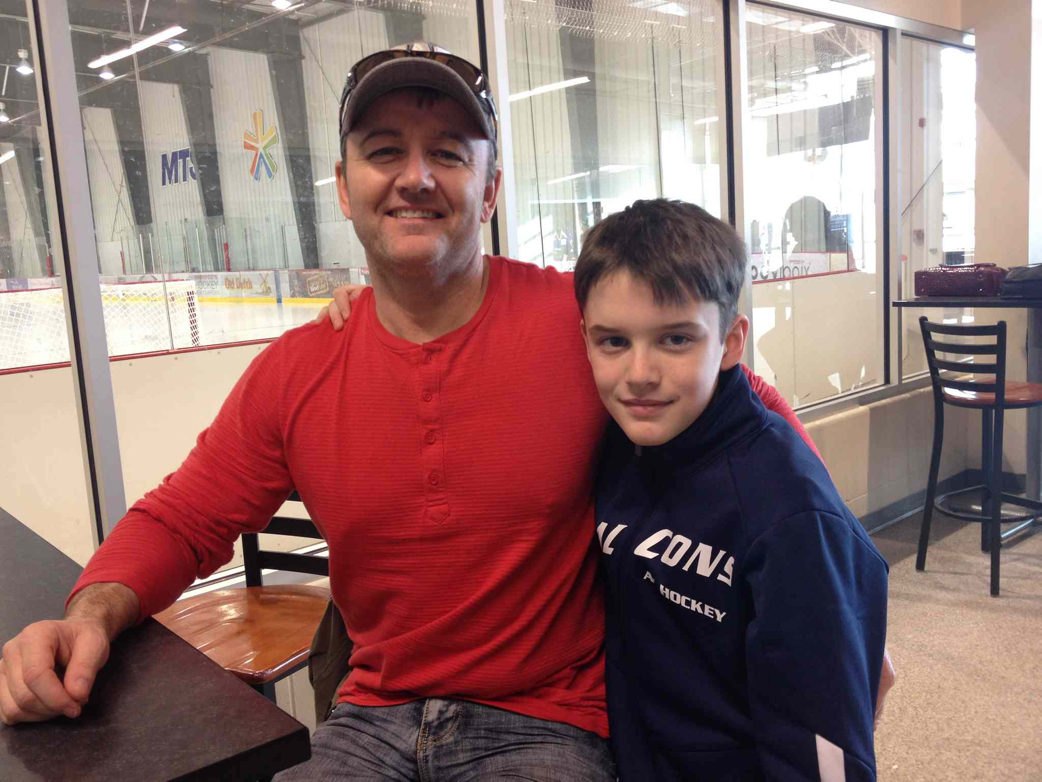 Rob Gibson and his son, Ethan, say Winnipeg's status as a 'hockey town' means fans have high expectations of their NHL team.