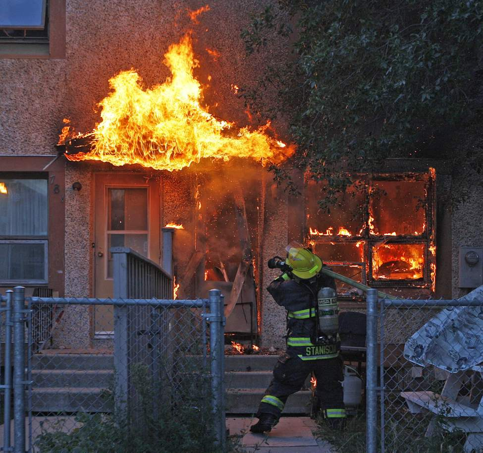Firefighters battles a blaze that was well involved  at a Winnipeg Housing complex on St. Joseph Street in St. Boniface. The fire started in the kitchen and spread rapidly to the rear of the housing unit . The male occupant was lucky to flee the 6:30 am fire without injury .