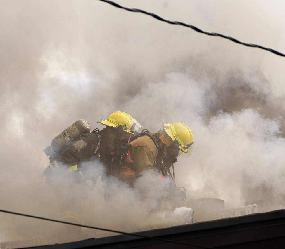 Heavy smoke engulfs firefighters during a house fire on Foxdale Avenue. JUNE 5 2013 