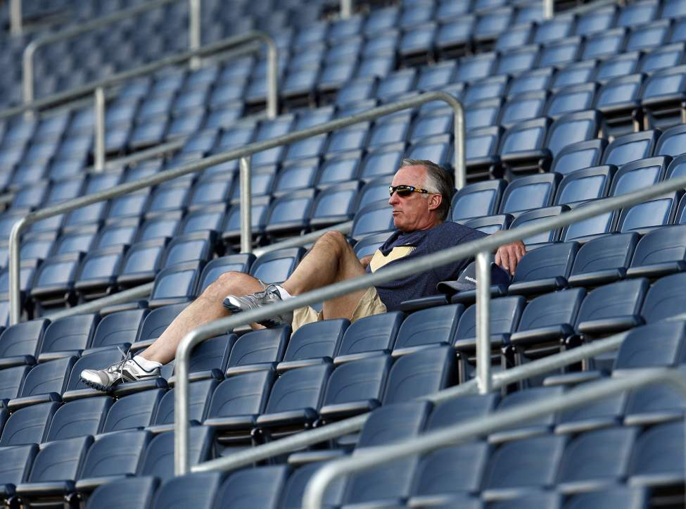 Embattled Winnipeg Blue Bomber GM Joe Mack takes in the view from the stands at practice. JULY 2 2013  (KEN GIGLIOTTI / WINNIPEG FREE PRESS)