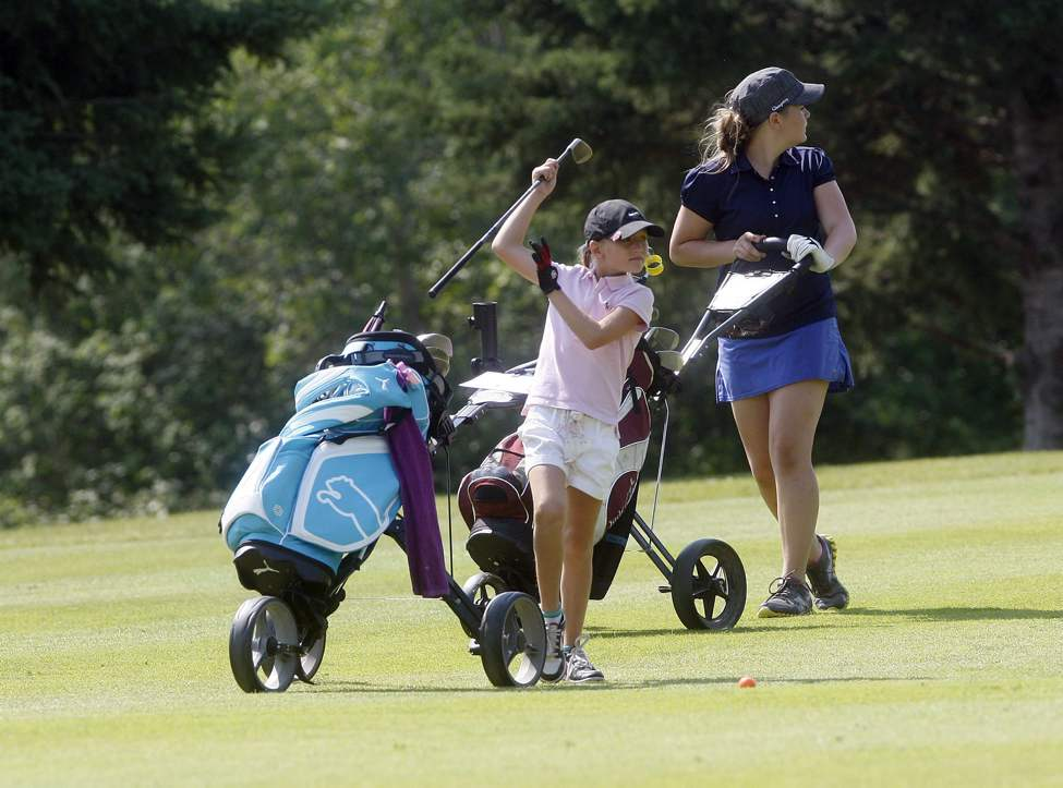 Round three of the Manitoba Junior Championship at Elmhurst Golf & Country Club began as  eight-year-old Reece Carter from Larters  pairs with 12-year-old Lily Hoydalo of Selkirk.  JULY 4 2013  (KEN GIGLIOTTI / WINNIPEG FREE PRESS)