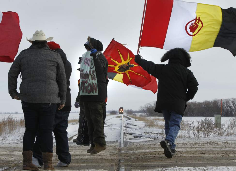 Protesters on the rail tracks near the Yellowhead Highway west of Portage la Prairie after the train stopped about 1 km away. The protest, organized by several aboriginal leaders including former Roseau River First Nation chief Terry Nelson, blocked a CN freight train and some traffic on the highway. January 16, 2013 (WAYNE GLOWACKI / WINNIPEG FREE PRESS)