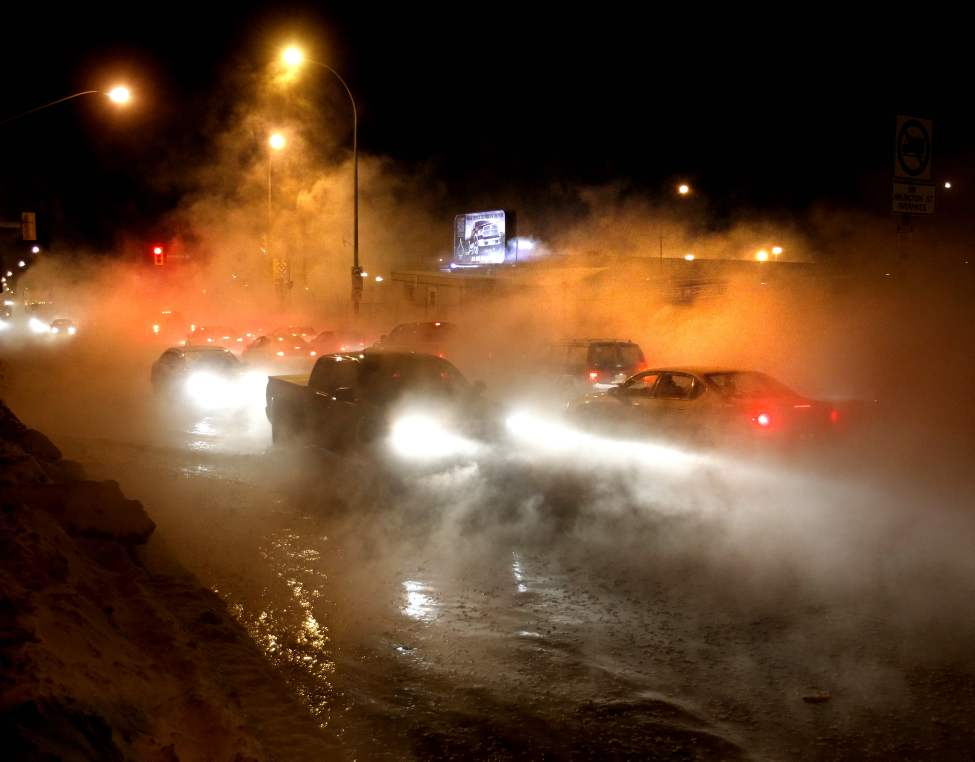 Traffic moves slowly on Logan Avenue at Arlington Street after a water main break flooded the intersection and created a dense fog. February 1, 2013 (WAYNE GLOWACKI/WINNIPEG FREE PRESS)