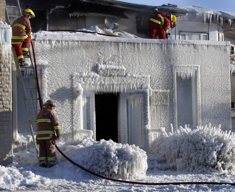 Firefighters check for hot spots after an overnight fire destroyed the Knysh Funeral Chapel on Park Avenue in Beausejour Mb.  March 19, 2013 (WAYNE GLOWACKI/WINNIPEG FREE PRESS)