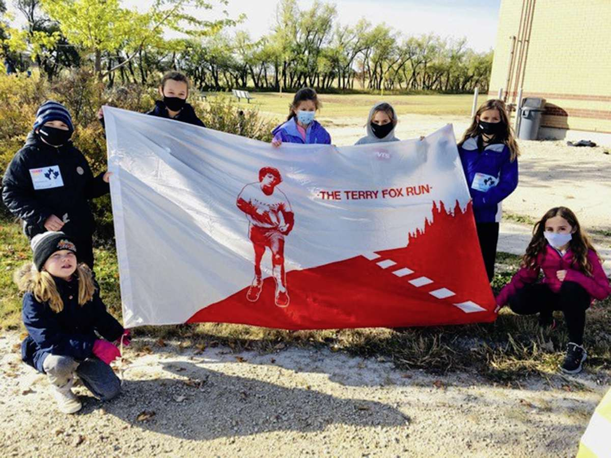 Starbuck School students gather around a banner the day of the Terry Fox School Run in October 2020. (SUPPLIED)