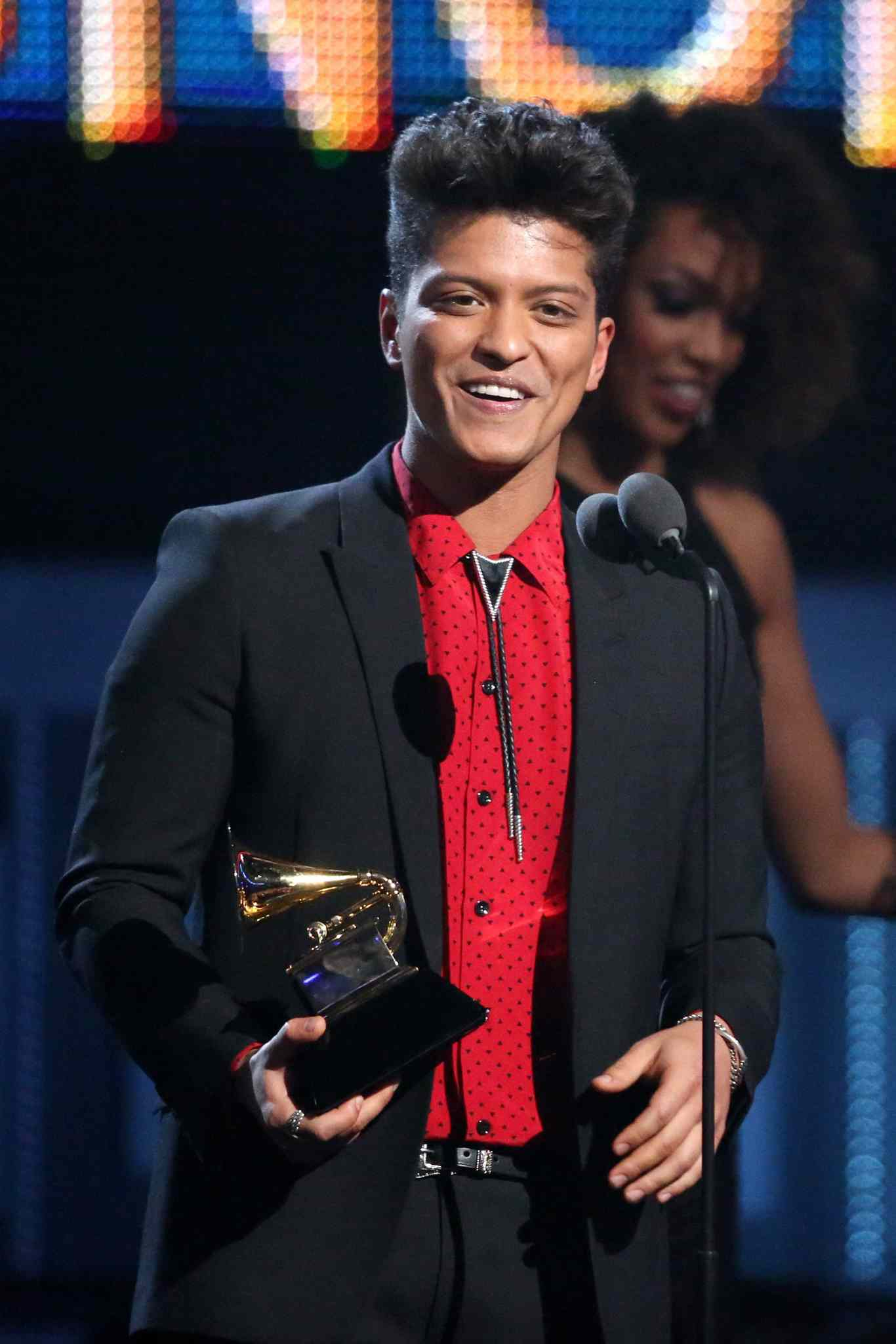 Bruno Mars accepts the award for best pop vocal album for Unorthodox Jukebox.