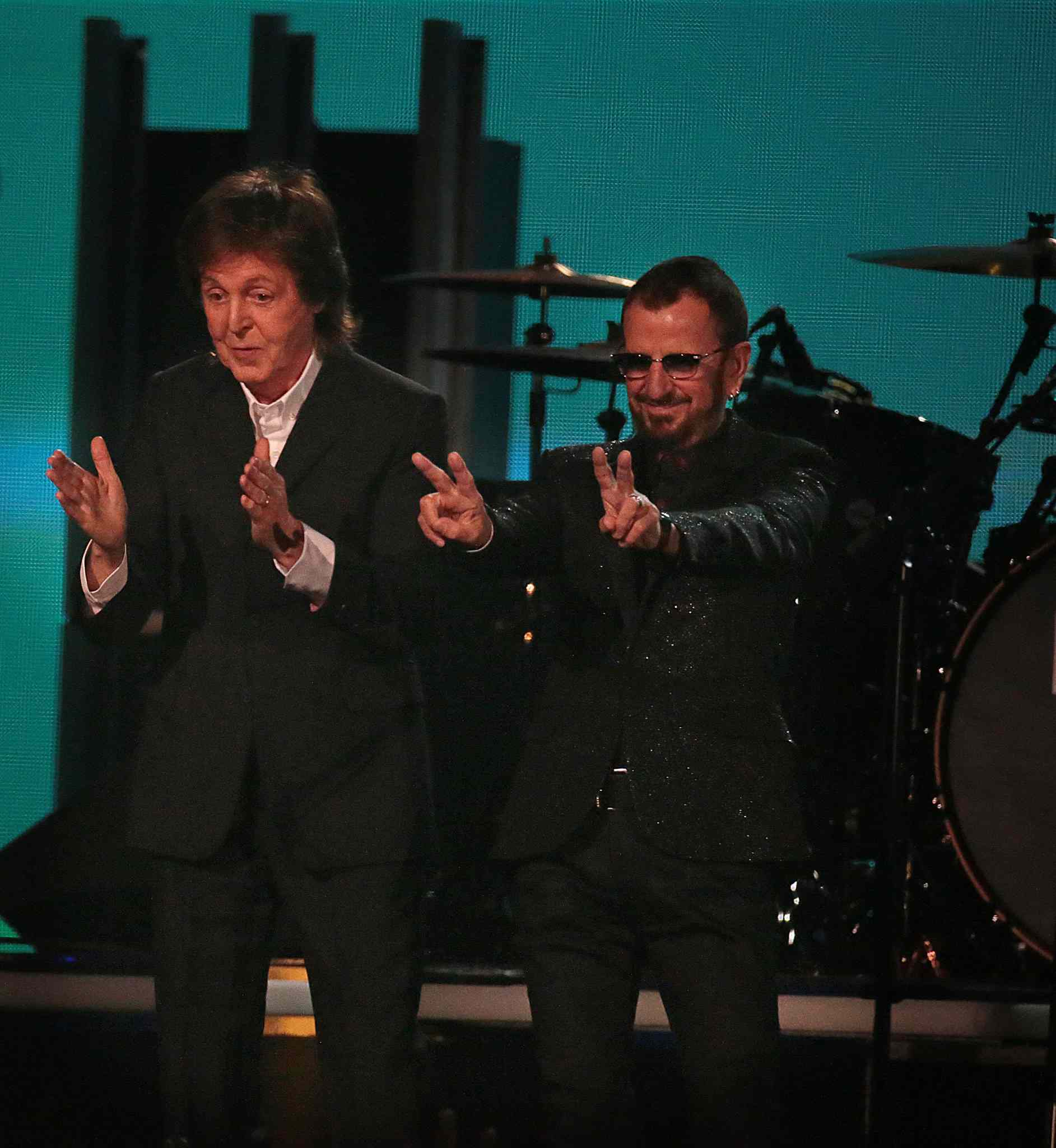 Paul McCartney and Ringo Starr take a bow at the 56th Annual Grammy Awards.
