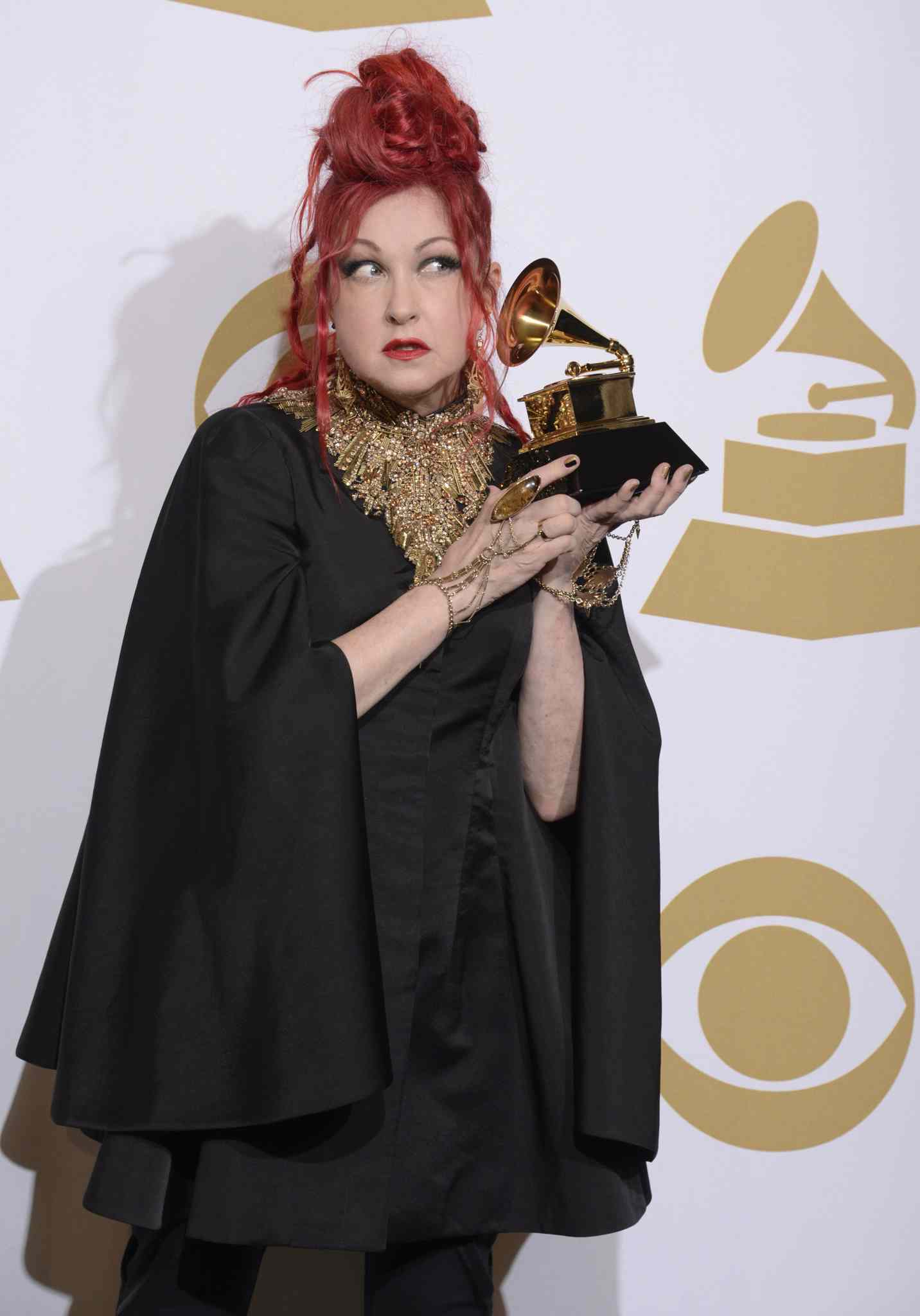 Cyndi Lauper poses the award for best musical theater album for Kinky Boots at the 56th annual Grammy Awards.