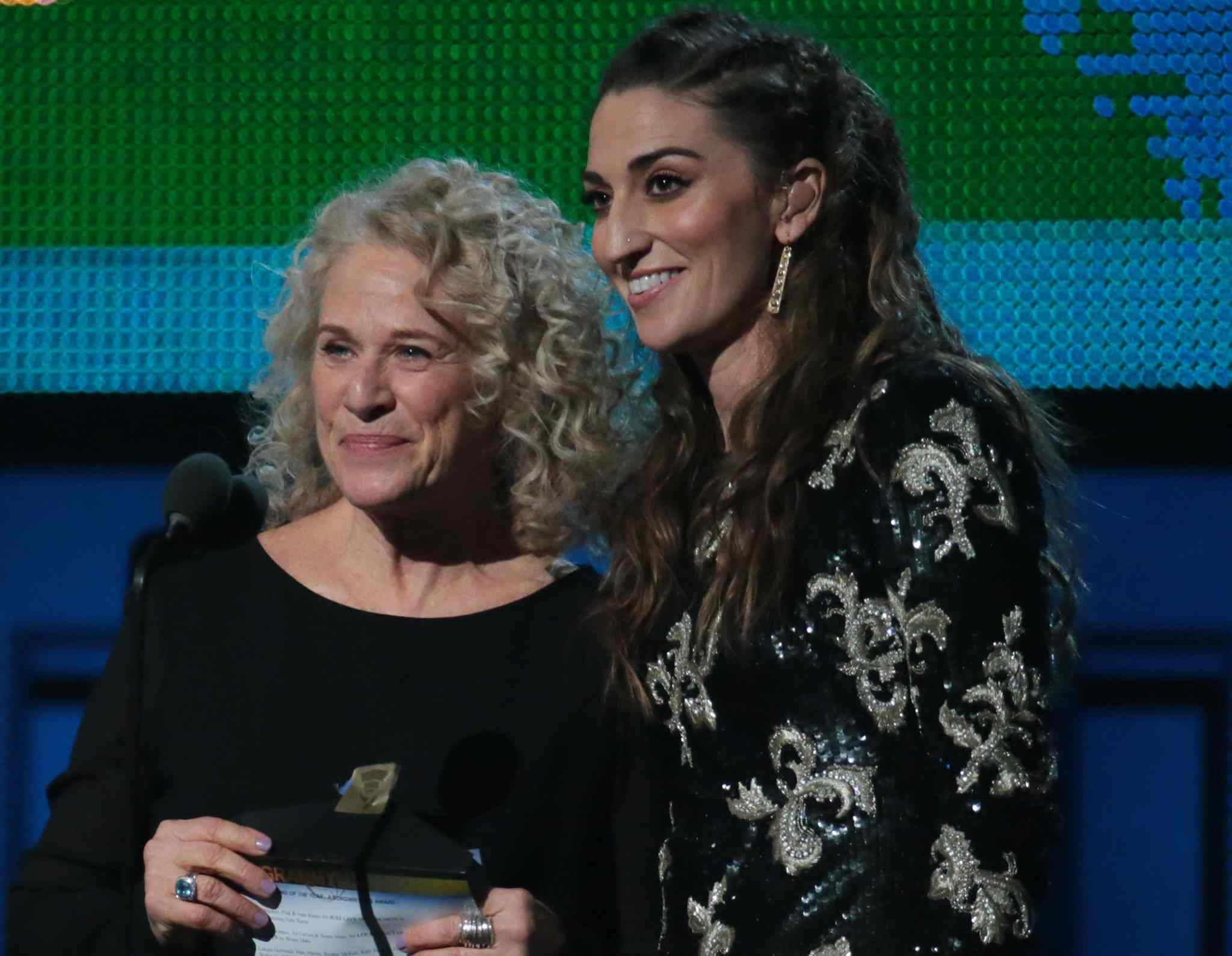 Carole King, left, and Sara Bareilles present the Song of the Year Grammy at the 56th Annual Grammy Awards.