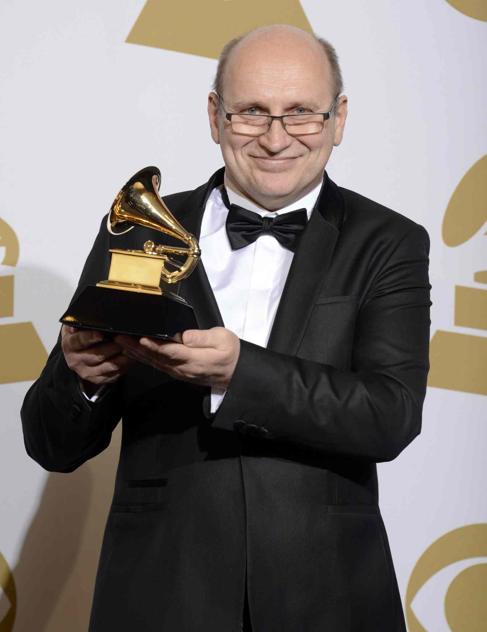 Wlodzimierz Pawlik poses  with the award for best large jazz ensemble album for Night In Calisia.