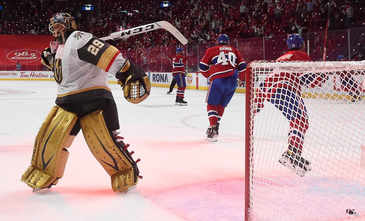Knights netminder Marc-André Fleury reacts after his giveaway to Josh Anderson led to the tying goal in Friday night's Game 3 in Montreal. Anderson would also score the winner in overtime.