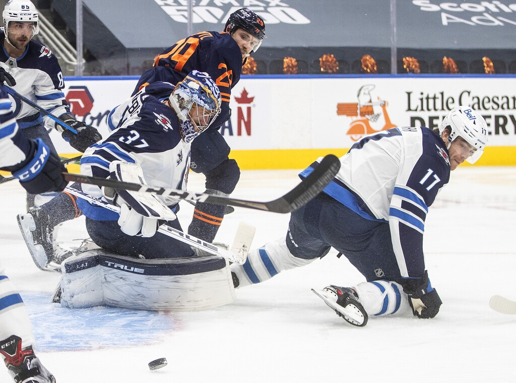 Connor Hellebuyck made 38 saves and earned a shutout. (Jason Franson / The Canadian Press)