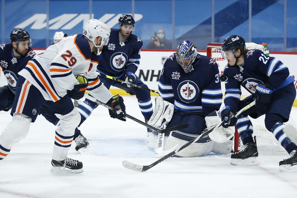 Connor Hellebuyck is going to have to be stellar in net to deal with the Oilers' firepower. (John Woods / The Canadian Press files)