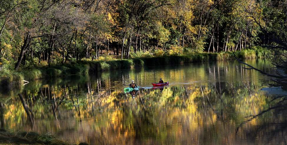 Kurt Penner and his son Matthias drift across the mirrored surface of the LaSalle River at LaBarrier Park enjoying the lingering fall weather. 