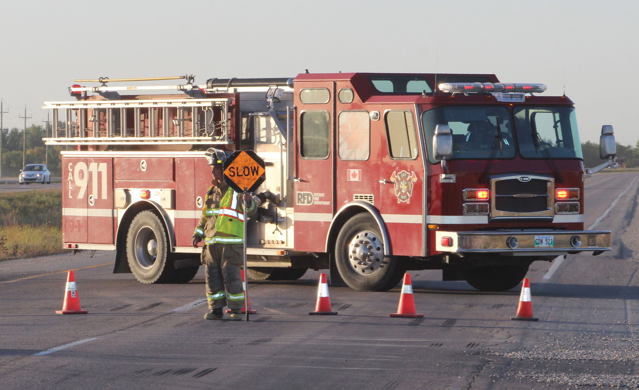 A member of the Ritchot Fire Department directs traffic on Highway 59 near Grande Pointe following a Thursday evening collision that left a 57-year-old cyclist dead.