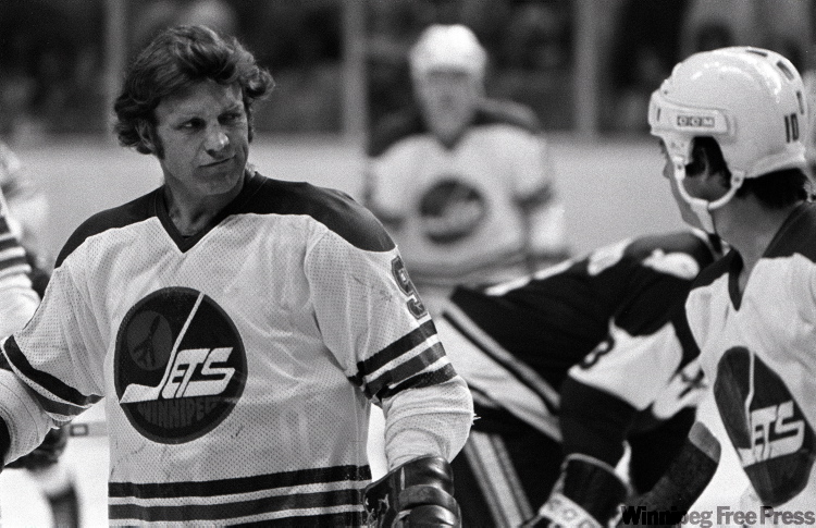 Bobby Hull gives Peter Sullivan a look during playoff action against New England on May 20, 1978.