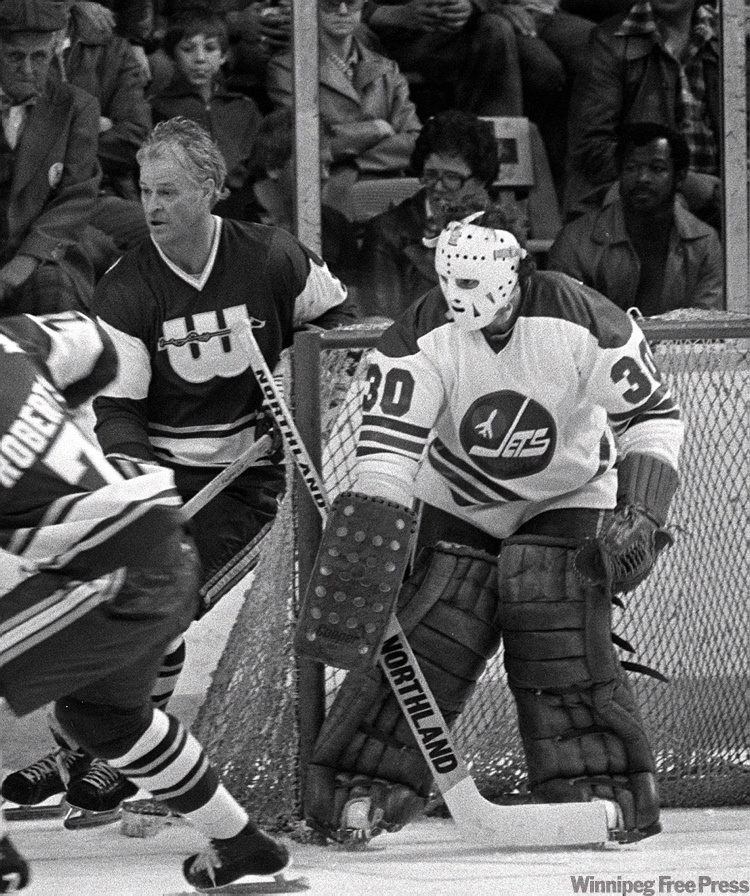 New England Whalers Gordie Howe in playoff game takes on Jets goalie #30 Markus Mattsson