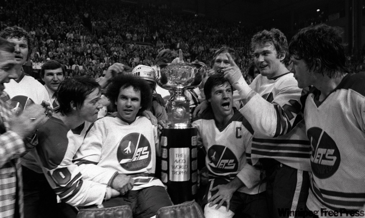 Jets goalie Joe Daley and captain Lars-Erik Sjoberg flank the Avco Cup on May 20, 1978, after winning it for the second time.