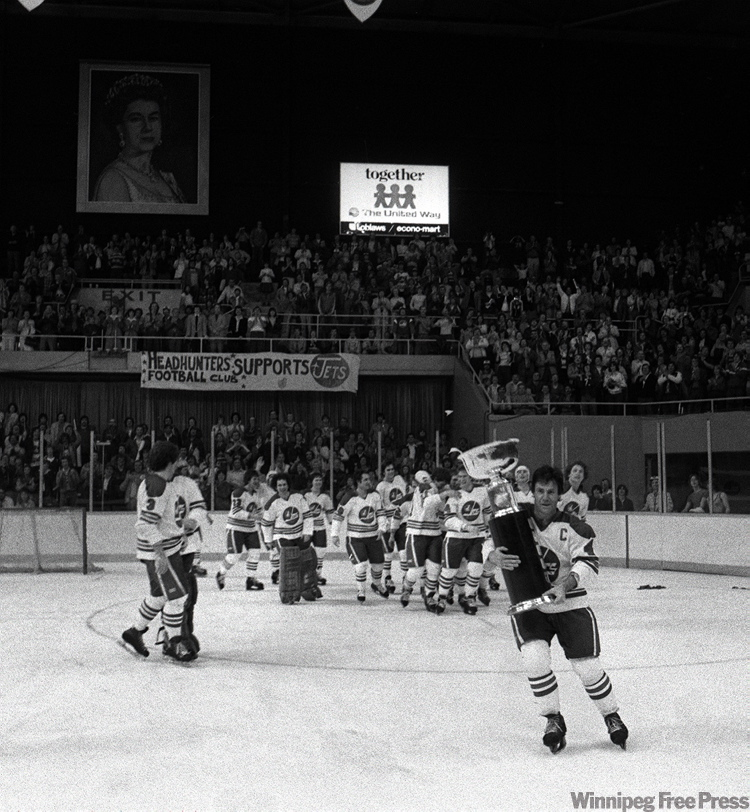 Jets captain Lars-Erik Sjoberg carries the team's second Avco Cup in victory skate around Winnipeg Arena on May 20, 1978.