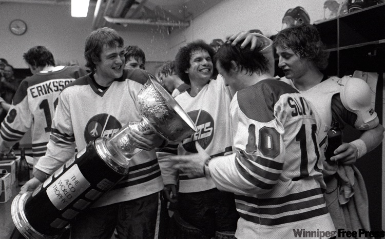 Jets celebrate their third Avco Cup. In centre of picture is goalie Joe Daley, Peter Sullivan #10 and Kent Nilson with Avco Cup.