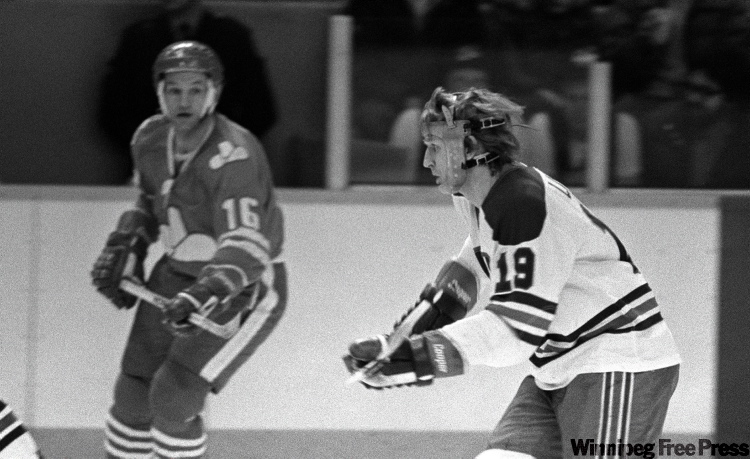 Mats Lindh wears apparatus to protect his broken jaw playing against  Calgary Cowboys.