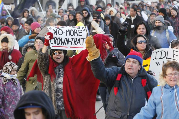 Hundreds held signs and marched to protest government inaction in solving First Nations issues. (Winnipeg Free Press)
