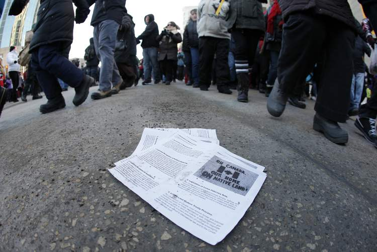Protesters distributed leaflets explaining their cause. (Winnipeg Free Press)