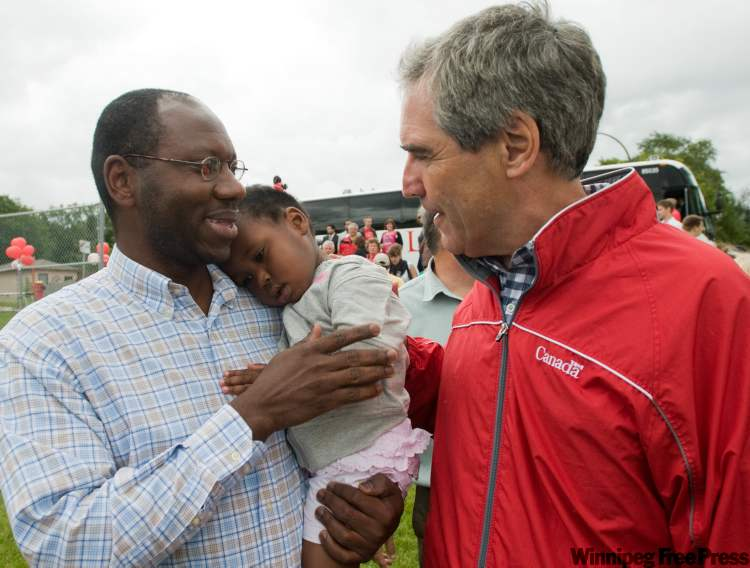 Liberal Party of Canada leader Michael Ignatieff greets Aiesha, 2, and dad Abdoulaye Bah at the Norwood Community Centre Saturday afternoon as part of his cross country tour.