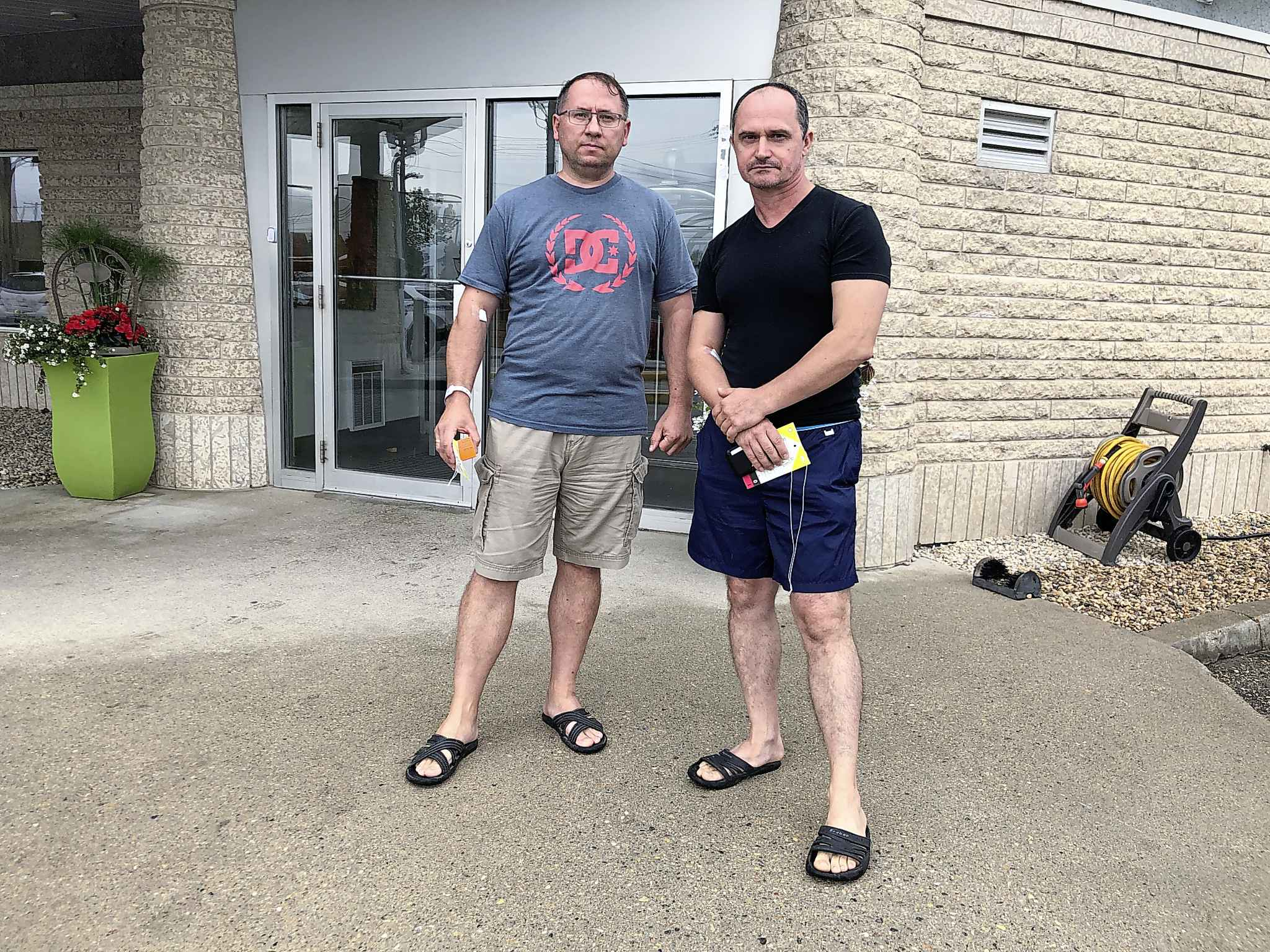 Sergiy Bolshakov and Oleg Lugovsky plan to continue their stay at the Super 8 despite the carbon monoxide incident. (Tessa Vanderhart / Winnipeg Free Press)