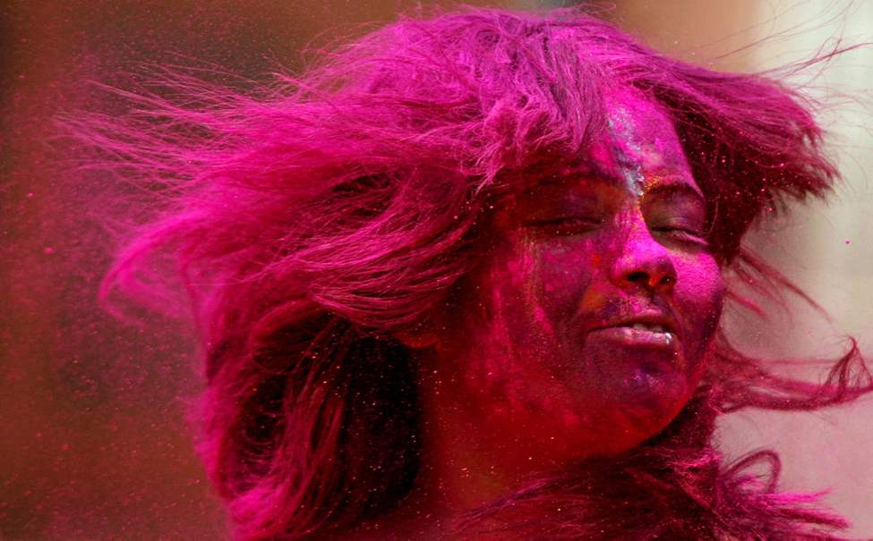 An Indian girl, her face smeared with colored powder, participates in Holi celebrations  in Chennai, India, Thursday, March 8, 2012. Holi, the Hindu festival of colors, also heralds the coming of spring. (AP Photo/Arun Sankar K.)