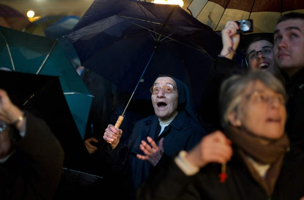 FILE - A nun reacts after white smoke billowed from the chimney on the Sistine Chapel indicating that a new pope has been elected in St. Peter's Square at the Vatican, Wednesday, March 13, 2013. Argentine Cardinal Jorge Bergoglio, who chose the name of Pope Francis, is the 266th pontiff of the Roman Catholic Church.  (AP Photo/Emilio Morenatti, File)