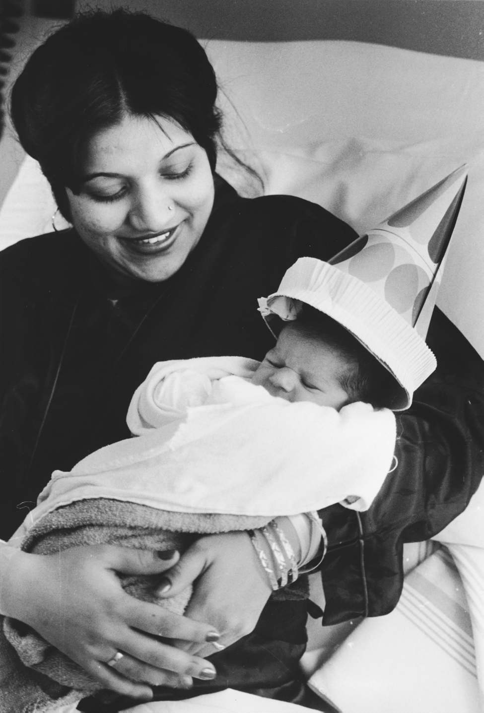 Harjit Kaur Singh celebrates New Year's Day with her son, Winnipeg's first baby of 1985. The as yet unnamed son of Harjit Singh and Harjit Kaur Singh was born at 12:32 a.m. at the St. Boniface General Hospital and weighed six pounds, 6.5 ounces.