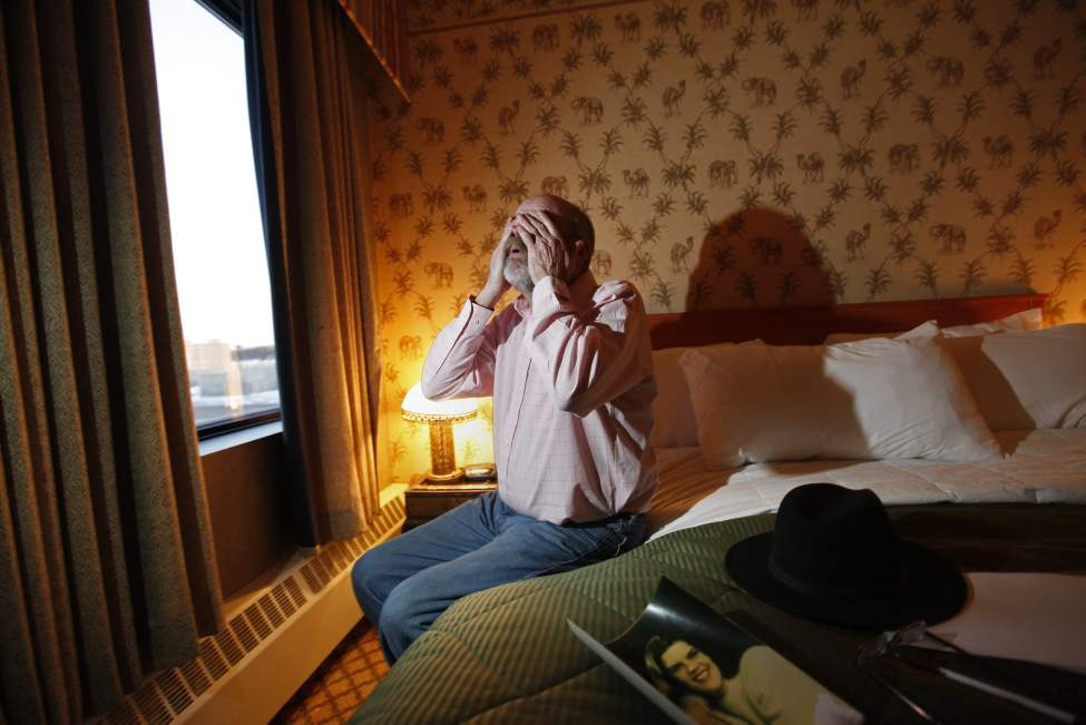 Michael Manning sits in his hotel room after giving an impact statement at Stony Mountain Institution Wednesday. Manning says the man who killed his daughter in 1994 should never have been allowed an aboriginal-style hearing, since the man is not aboriginal.  January 18, 2012  (Ruth Bonneville /  Winnipeg Free Press)