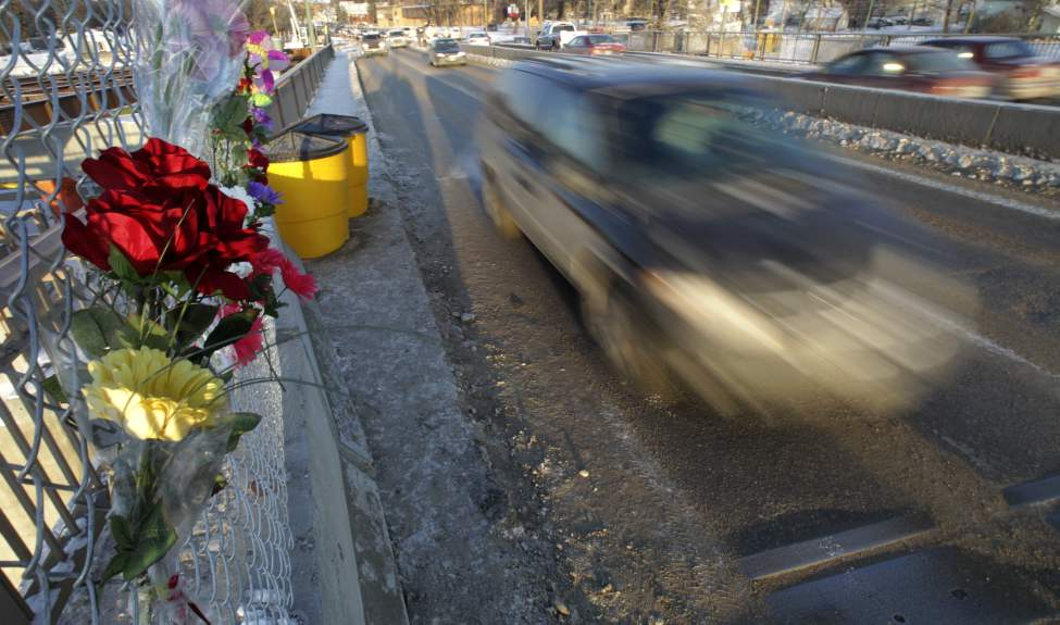 Concrete barriers block the gap in the handrail that was broken when Kaitlyn Jenna Lee Fraser, 19, lost control of her car and drove off the Disraeli Bridge plummeting over thirty feet to her death.  January 19, 2012   (MIKE DEAL / WINNIPEG FREE PRESS) (MIKE DEAL / WINNIPEG FREE PRESS)