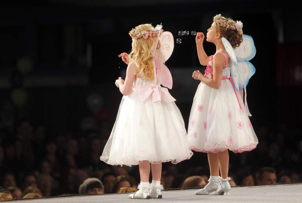 The Wonderful Wedding Show. Young angels in the fashion show blow bubbles to the crowd. January 22, 2012 