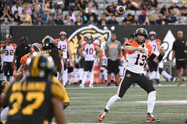 B.C. Lions quarterback Mike Reilly throws the ball downfield against the Hamilton Tiger-Cats during first half CFL football game action in Hamilton, Ontario on Saturday, August 10, 2019. It seem's Mike Reilly does know Mike Reilly best.The veteran quarterback was a full participant at B.C.'s practice Monday after suffering an ankle injury in the Lions' 35-34 road loss to Hamilton on Saturday night. THE CANADIAN PRESS/Jon Blacker