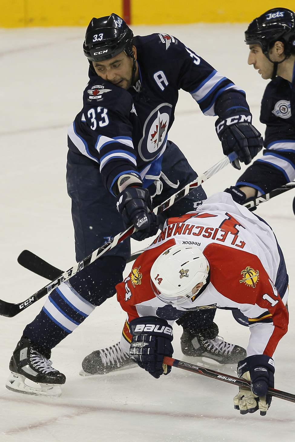 Winnipeg Jets defenceman Dustin Byfuglien (33) checks Florida Panthers forward Tomas Fleischmann (14) during first period NHL action in Winnipeg on November 10, 2011. (John Woods / WINNIPEG FREE PRESS)