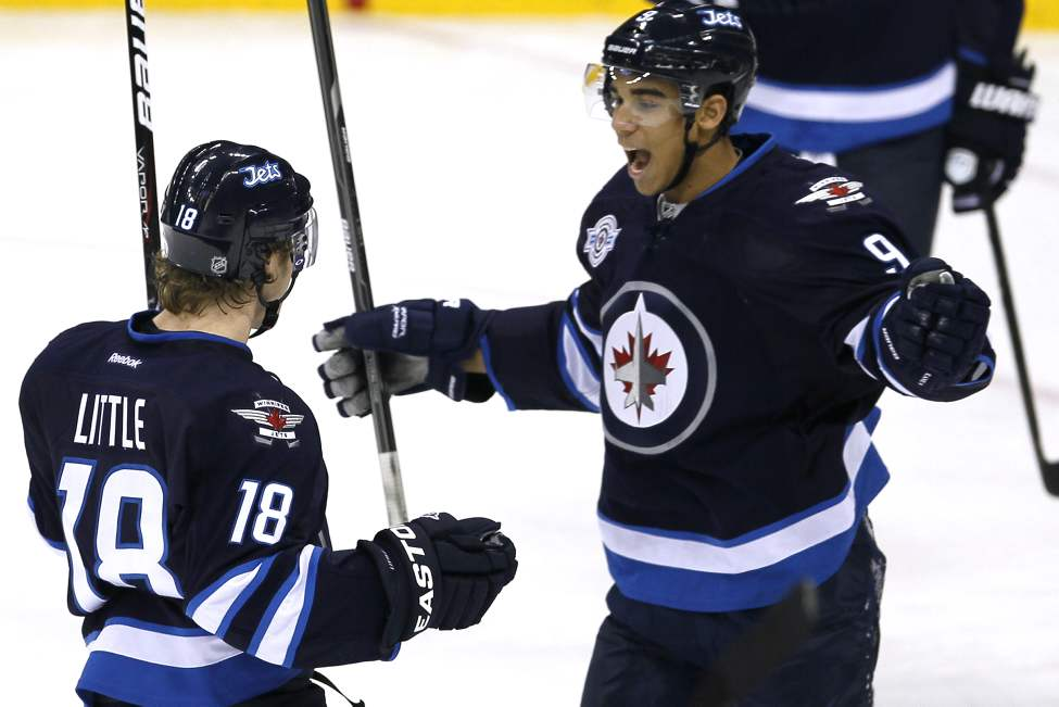Winnipeg Jets' forward Evander Kane (9) and forward Bryan Little (18) celebrate Little's goal against the Philadelphia Flyers during first period NHL action in Winnipeg on November 19, 2011. (John Woods / WINNIPEG FREE PRESS)