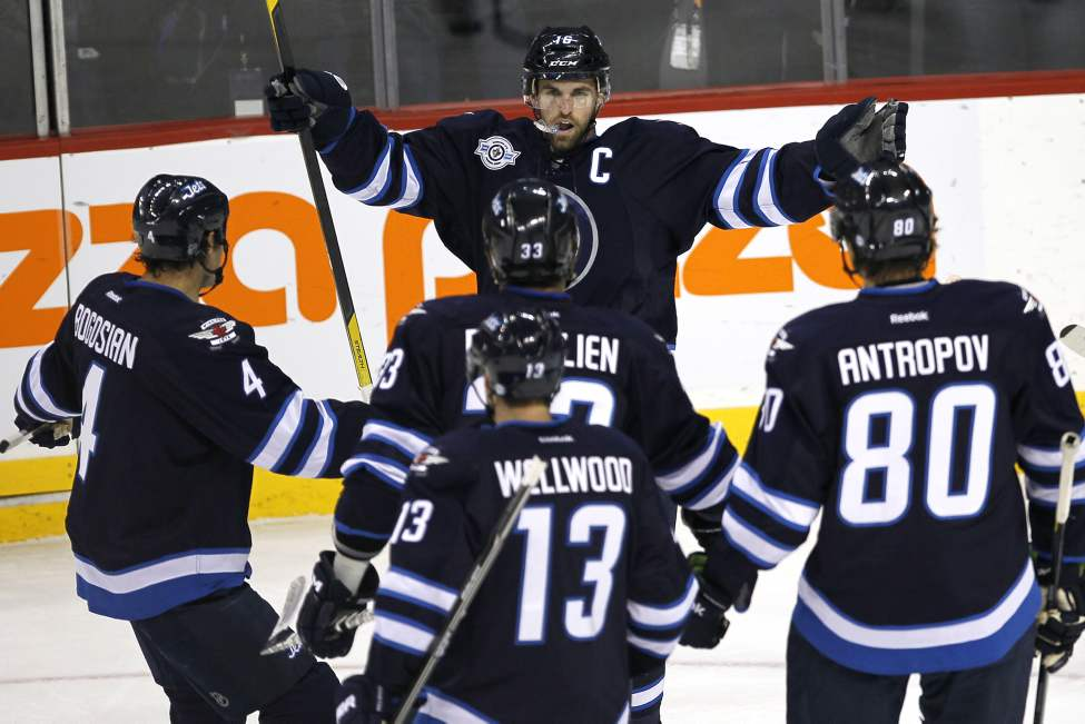 Winnipeg Jets' forward Andrew Ladd (16) celebrates his goal against the Philadelphia Flyers' during first period NHL action in Winnipeg on November 19, 2011. (John Woods / WINNIPEG FREE PRESS)
