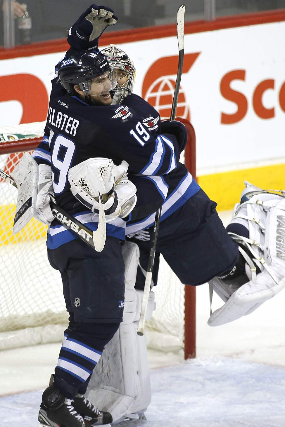 Winnipeg Jets' forward Jim Slater (19) and goaltender Ondrej Pavelec (31) celebrate a win over the Boston Bruins in NHL action in Winnipeg on December 6, 2011. (John Woods / WINNIPEG FREE PRESS)