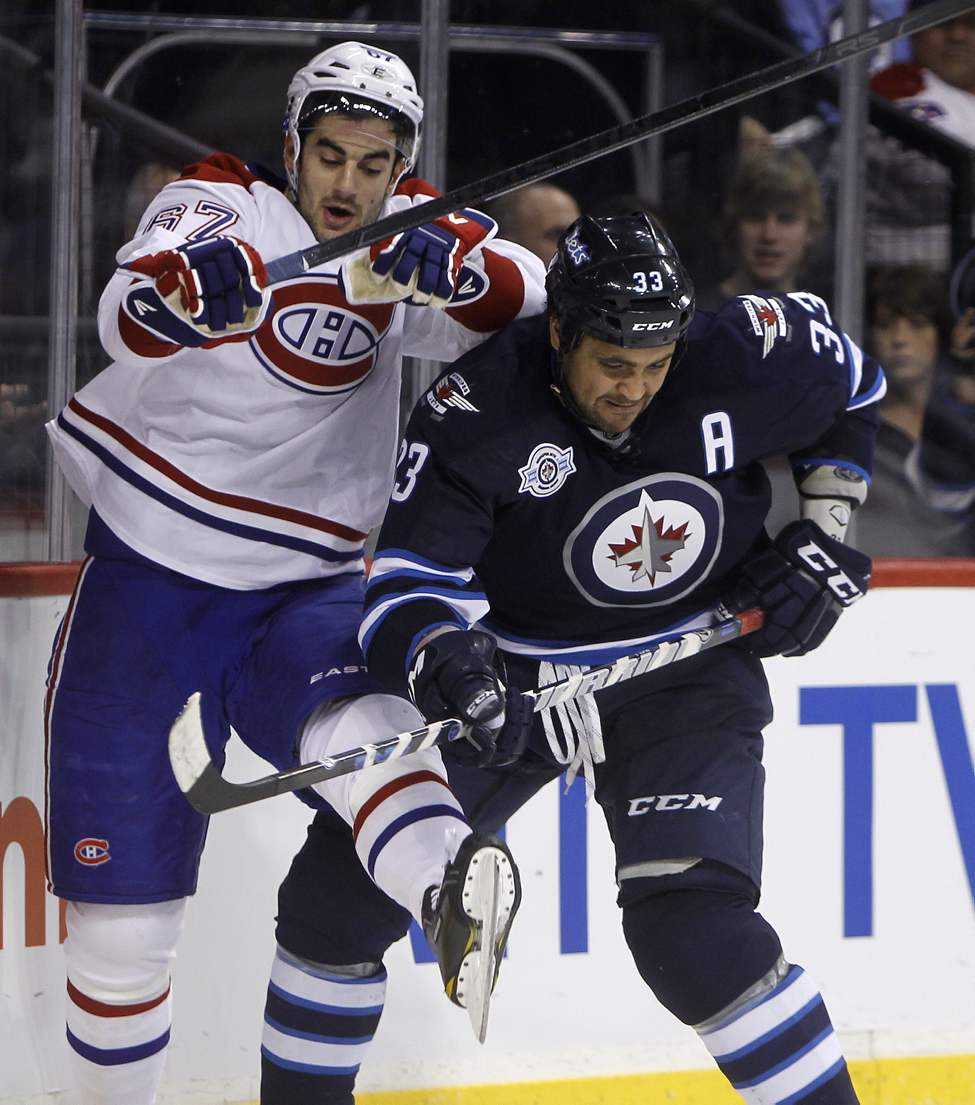 Montreal Canadiens' Max Pacioretty (67) is bumped by Winnipeg Jets' Dustin Byfuglien (33) during the third period of play at MTS Centre, December 22, 2011. (TREVOR HAGAN/WINNIPEG FREE PRESS)