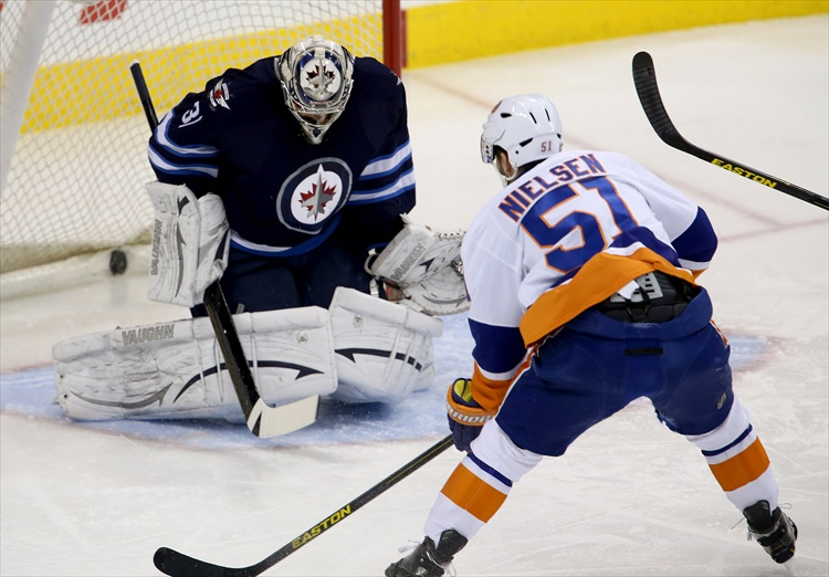 New York Islanders' Frans Nielsen puts the puck past Winnipeg Jets' goaltender Ondrej Pavelec to open the scoring during first period action. (Trevor Hagan / Winnipeg Free Press)