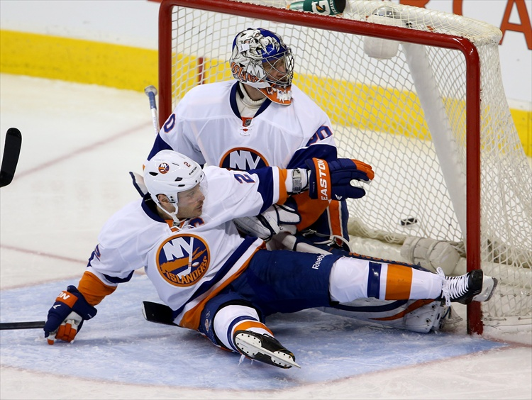 Mark Streit falls into goaltender Evgeni Nabokov during the third period. (Trevor Hagan / Winnipeg Free Press)