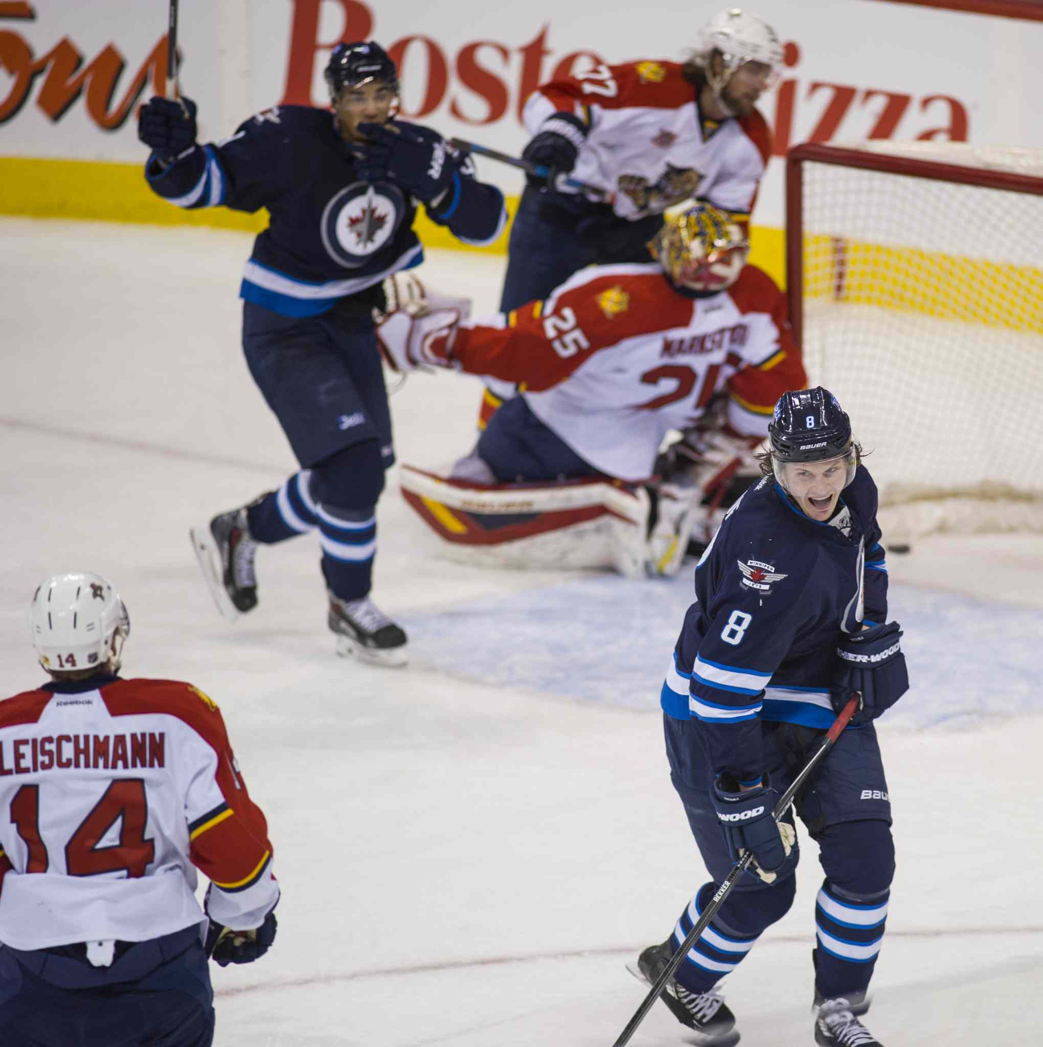 Winnipeg Jets Jacob Trouba (#8) celebrates his goal on Florida Panthers goal tender Jacob Markstrom (#25) during the first period action.