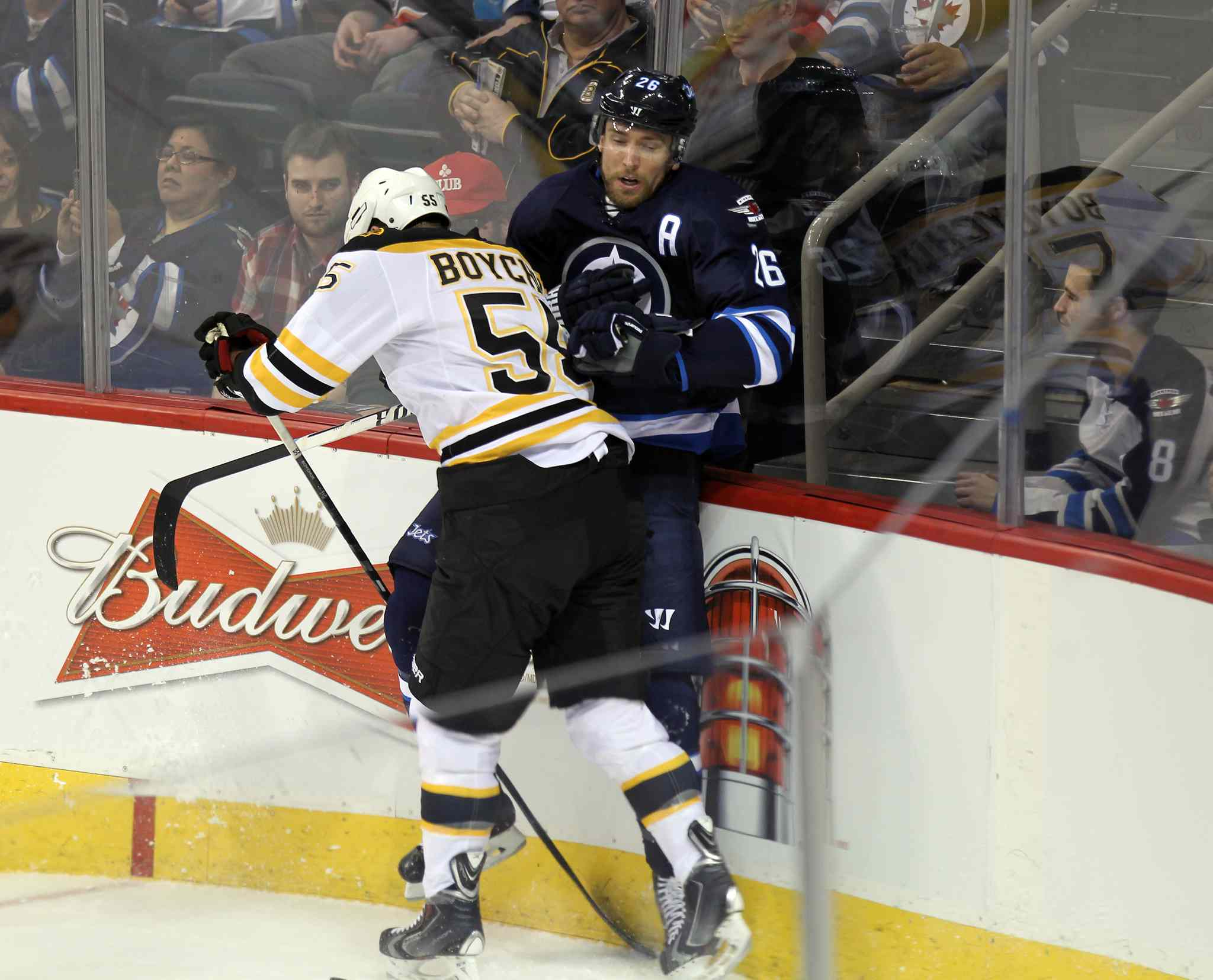 Bruins' Johnny Boychuk takes out Jets' Blake Wheeler in the first period.