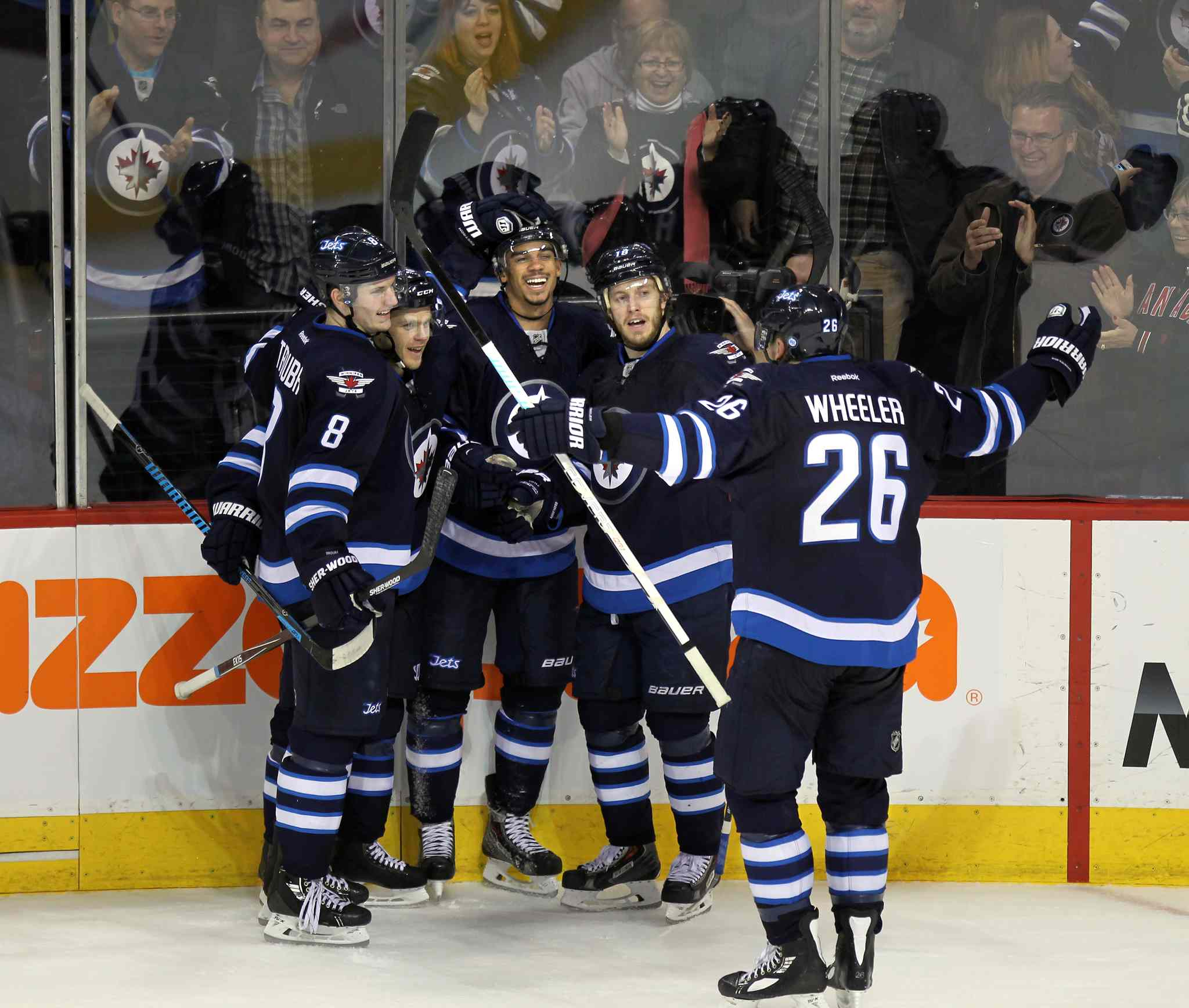 Jets' Blake Wheeler skates in to congratulate teammate Evander Kane for scoring the tying goal against the Boston Bruins Thursday at the MTS centre.