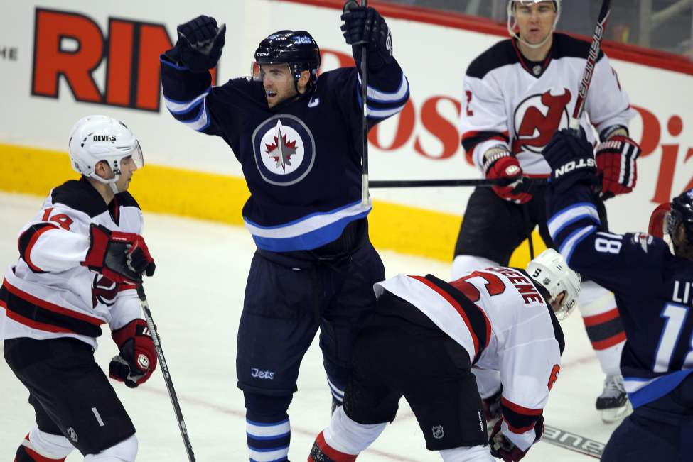 Third-period action - Andrew Ladd scores his second goal.  (Boris Minkevich / Winnipeg Free Press)