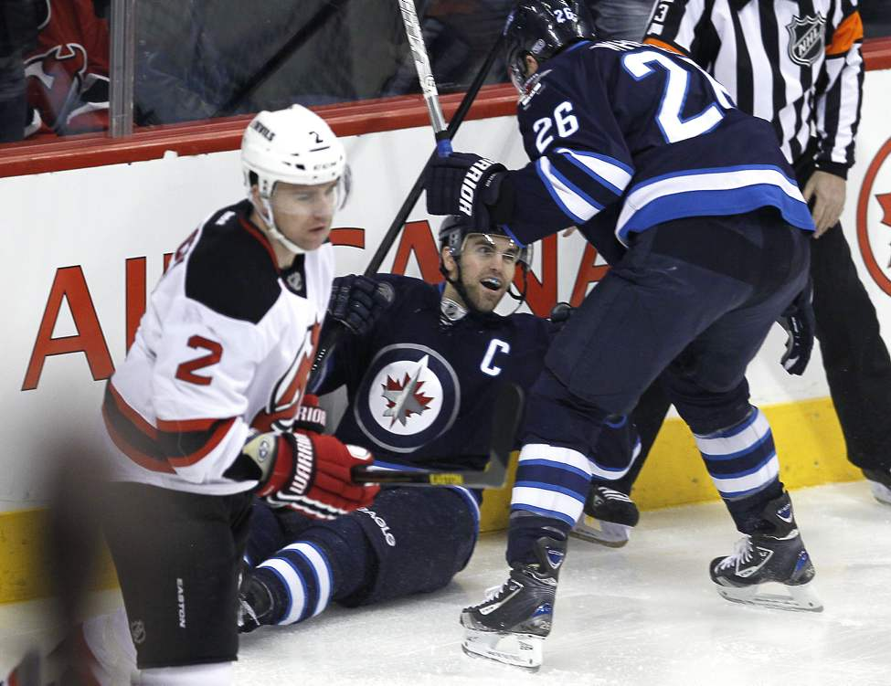 Winnipeg Jets' Andrew Ladd (16) celebrates his first-period goal against the New Jersey Devils with teammate Blake Wheeler (26). (THE CANADIAN PRESS/John Woods)